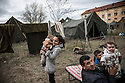 A Syrian family at Harmanli, a former military camp near the Turkish border. Beginning in 2013, officials placed refugees inside military tents with only dirt floors even during the winter months, when it was cold and damp and many people suffered from respiratory infections.