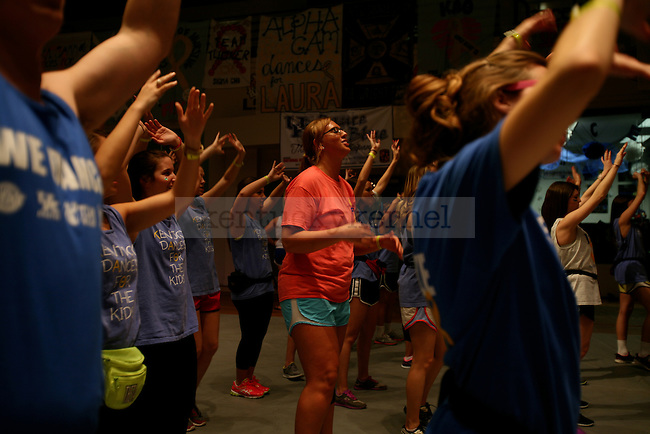Communications senior Liz Pawley does the hourly line dance during DanceBlue, a 24 hour dance marathon to raise money for pediatric cancer research at Memorial Coliseum in Lexington, Ky. on Saturday, February 23, 2013. Photo by Genevieve Adams