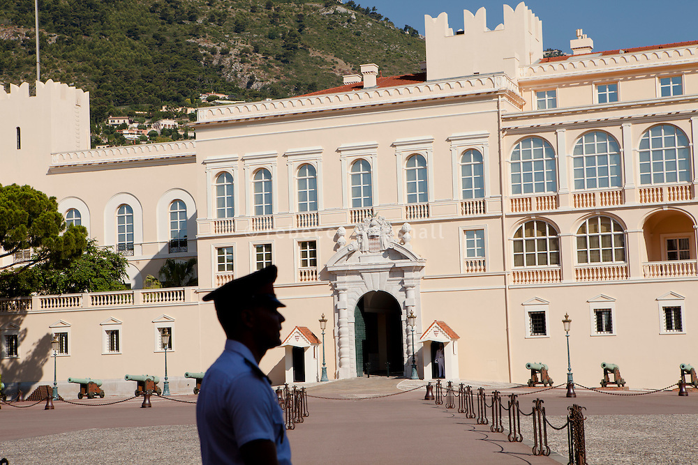 A carabinier, one of the Prince of Monaco's official guards, stands watch in front of the Prince's Palace, Monaco, 5 July 2013. The palace, built in 1191, is today the home of Prince Albert II, Monaco's head of state.