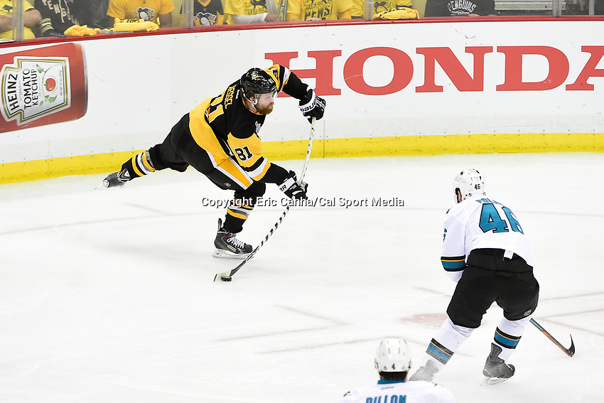Thursday, June 9, 2016: Pittsburgh Penguins right wing Phil Kessel (81) shoots the puck out of his zone during game 5 of the NHL Stanley Cup Finals  between the San Jose Sharks and the Pittsburgh Penguins held at the CONSOL Energy Center in Pittsburgh Pennsylvania. The Sharks defeat the Penguins 4-2 in regulation time. The Penguins lead the best of seven series 3-2. Eric Canha/CSM