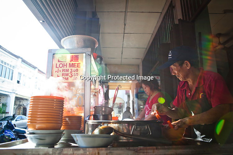 An old man prepares Loh Mee in his stall at a local kopitiam (traditional Chinese breakfast and coffee shop) in capital Georgetown of Penang in Malaysia. Photo: Sanjit Das/Panos