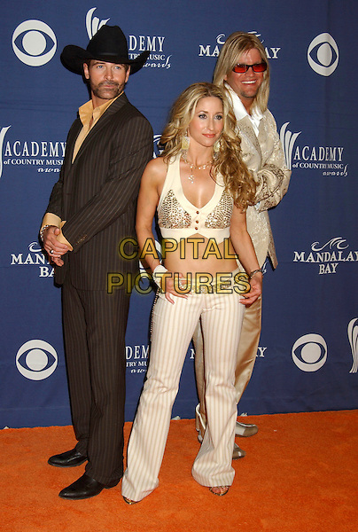 HEIDI NEWFIELD OF TRICK PONY.The 40th Annual Academy of Country Music Awards (ACM) held at Mandalay Bay Resort & Casino, Las Vegas, Nevada, USA, 17 May 2005..full length cropped top midriff tummy .Ref: ADM.www.capitalpictures.com.sales@capitalpictures.com.©Laura Farr/AdMedia/Capital Pictures.