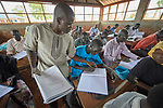 A teacher helps students in an English class in the Arrupe Learning Center, run by Jesuit Refugee Service in Bunj, South Sudan. Participants come from four refugee camps in Maban County that together shelter more than 130,000 refugees from the Blue Nile region of Sudan, along with local residents from the host community.<br /> <br /> Misean Cara provides support for the work of Jesuit Refugee Service in Maban.