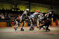 Sarah Doom pulls at Shellby Shattered's shorts during a roller derby bout in Wilmington, Massachusetts. Roller derby is an American contact sport, popular with young women, which combines both athleticism and a satirical punk third-wave feminism aesthetic.