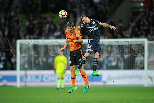 30th April 2017, AAMI Park, Melbourne, Australia; Hyundai A-League Football; Melbourne Victory versus Brisbane Roar FC; Thomas Kristensen of the Brisbane Roar and Leigh Broxham of the Melbourne Victory jump for the ball during the second half