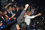 Israel's Foreign Minister and Kadima party candidate Tzipi Livni stands in the DJ post, as she attends an election campaign party in a dance club in Tel Aviv, Israel, Tuesday, February 3, 2009 (Photo by Ahikam Seri).