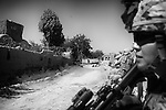 US troops from 1-38 Infantry take cover during a short lull in the fighting in Pay-E Moluk village in Panjwayi, Kandahar, 30 April 2013. The patrol was ambushed and turned into a five hour firefight. (John D McHugh)