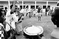 "Burundi. Karuzi Province. Karuzi. Young boys from the music group ""Karuzi's drums"" play the drums and rehearse in the school yard the programm of their next musical performance .They all wear western clothes.  © 2000 Didier Ruef"