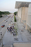 People gather outside the entrance to the new Renzo Piano-designed modern wing to the Art Institute Chicago across the street from Millennium Park in Chicago, Illinois on July 23, 2009.  An elevated footbridge connects the museum to the park.