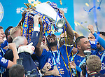 Leicester's Wes Morgan celebrates with the trophy during the Barclays Premier League match at the King Power Stadium.  Photo credit should read: David Klein/Sportimage