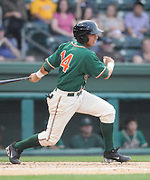 Infielder Pedro Mendoza (14) of the Greensboro Grasshoppers, Class A affiliate of the Florida Marlins, in a game against the Greenville Drive on April 26, 2011, at Fluor Field at the West End in Greenville, South Carolina. (Tom Priddy/Four Seam Images)