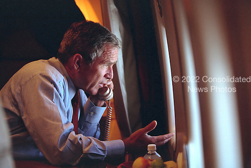 After departing Offutt Air Force Base in Bellevue, Nebraska, United States President George W. Bush confers with U.S. Vice President Dick Cheney from Air Force One during his flight to Andrews Air Force Base, Maryland, Tuesday, September 11, 2001..Mandatory Credit: Eric Draper - White House via CNP.