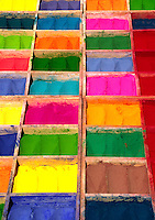 A TIKA stand sports colored powders which are used to make the TILAKA MARKINGS on the foreheads of SADHUS - KATHAMANDU, NEPAL