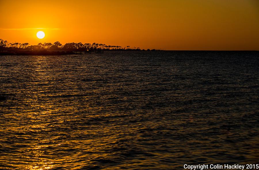 St. GEORGE ISLAND, FLA., 11/25/15- The sun sets over the western end of St. George Island, Fla. <br /> <br /> COLIN HACKLEY PHOTO