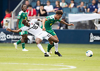 KANSAS CITY, KS - JUNE 26: Kevin Molino #10 and Elliot Bonds #4 battle for the ball during a game between Guyana and Trinidad