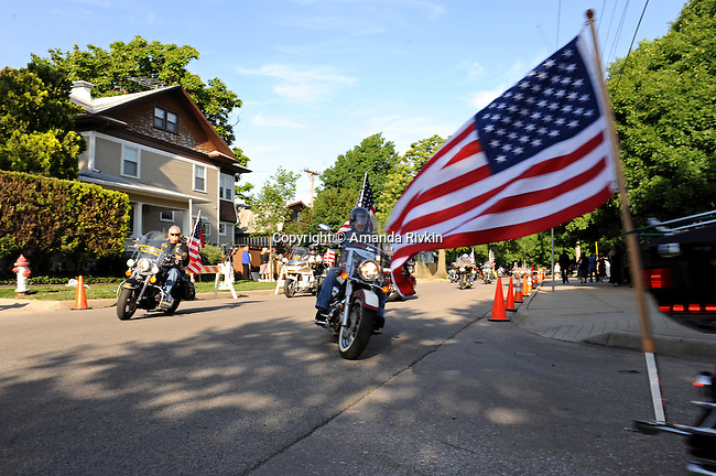 The American Legion Riders arrive in a patriotic show of support outside the College Hill United Methodist Church before the funeral for assassinated abortion doctor George Tiller in Wichita, Kansas on June 6, 2009.  Tiller was gunned down while serving as an usher at his church last Sunday by Scott Roeder, who is now in custody, in a political crime with reverberations across the region and the country; Tiller's Wichita clinic had previously served as a culture wars flashpoint in the 1990s.