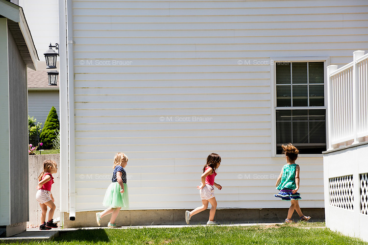 Lora Reyes is a licensed family childcare educator in Westfield, Mass., where she operates the daycare Lora's Little Ones out of her home on Thurs., June 2, 2016. Here she guides the children indoors after outside playtime for lunch. Today she was in charge of 7 children, aged 14 months to 5 years old, handling meals, playtime, and educational activities throughout the day, starting about 7am and going until 4:30pm. She uses the Mother Goose Time curriculum throughout the day. Reyes is currently pursuing an undergraduate degree in Psychology at Holyoke Community College. She started 2 years ago after earning a Child Development Associate certification.