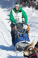 Colleen Robertia on Long Lake at the Re-Start of the 2012 Iditarod Sled Dog Race