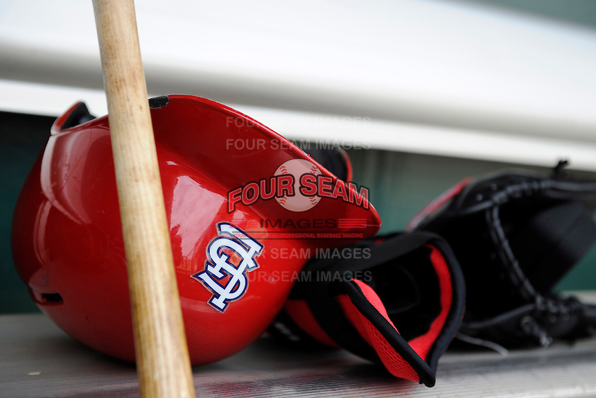 St. Louis Cardinals batting helmet and gloves sit on the bench before a Spring Training game against the Houston Astros at Osceola County Stadium on March 1, 2013 in Kissimmee, Florida.  The game ended in a tie at 8-8.  (Mike Janes/Four Seam Images)