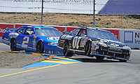 Jun. 21, 2009; Sonoma, CA, USA; NASCAR Sprint Cup Series driver Casey Mears (07) leads Kurt Busch during the SaveMart 350 at Infineon Raceway. Mandatory Credit: Mark J. Rebilas-