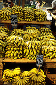 Rio de Janeiro, Brazil. Street market stall selling piles of bunches of ripe yellow bananas.
