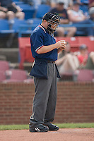 Home plate umpire Brent Rice checks a baseball to see if it can be reused at Wake Forest Baseball Stadium June 14, 2009 in Winston-Salem, North Carolina. (Photo by Brian Westerholt / Four Seam Images)