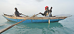 A year after Hurricane Matthew ravaged parts of Haiti, men harvest fish from a small boat off the coast of northwestern Haiti near the village of Plateforme. The village was ravaged in the storm, and Lutheran World Relief, a member of the ACT Alliance, has helped the community rebuild its economy with fishing materials, a solar-powered refrigerator room for storing their catch, and other assistance.