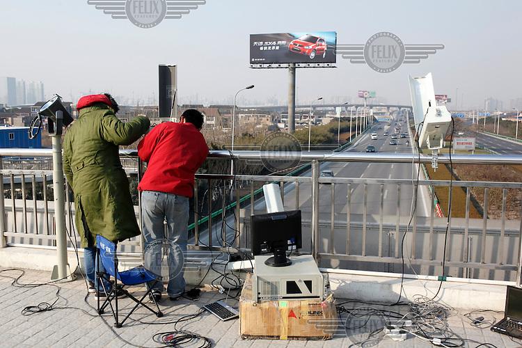 Technicians install traffic cameras in Shanghai.