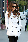 December 7th 2011...Kate Beckinsale shopping at Fred Segal on Melrose Ave in West Hollywood California. Kate was wearing a white jacket coat with big black buttons looking at books...AbilityFilms@yahoo.com.805-427-3519.www.AbilityFilms.com..