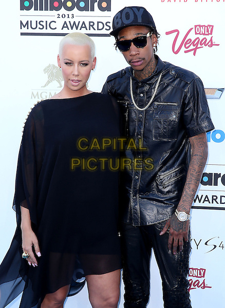 Amber Rose, Wiz Khalifa.2013 Billboard Music Awards held at the MGM Grand Garden Arena, Las Vegas, Nevada, USA..May 19th, 2013.half length black dress sheer leather shirt hat cap sunglasses shades couple jeans denim mouth open.CAP/ADM/MJT.© MJT/AdMedia/Capital Pictures