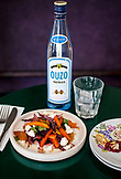ISRAEL, Tel Aviv, Carrots and Beets Salad, a bottle of Ouzo, in Uzeria Restaurant,