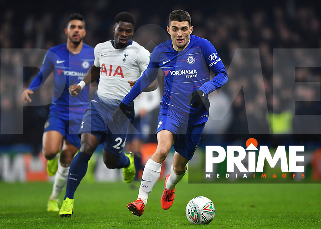 Mateo Kovacic of Chelsea is chased by Serge Aurier of Tottenham Hotspur during the Carabao Cup Semi-Final 2nd leg match between Chelsea and Tottenham Hotspur at Stamford Bridge, London, England on 24 January 2019. Photo by Vince  Mignott / PRiME Media Images.