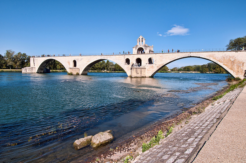 The Pont d'Avignon, otherwise known as the Pont Saint-Bénezet, the subject of a popular children's song, was originally constructed during the 12th century, and was reconstructed from time to time after repeatedly being partially washed away by the cresting of the Rhone River. It has been left in its present state since the 17th century.