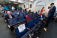 Reporters take their places before a news briefing by members of the Coronavirus Task Force in the Brady Press Briefing Room at the White House in Washington, DC on Monday, March 23, 2020.<br /> Credit: Chris Kleponis / Pool via CNP/AdMedia