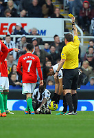 Saturday 17 November 2012<br /> Pictured: Leon Britton of Swansea referee Phil Dowd yellow card, Cheick Tiote <br /> Re: Barclay's Premier League, Newcastle United v Swansea City FC at St James' Park, Newcastle Upon Tyne, UK.