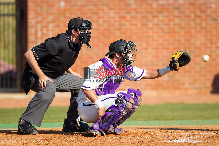High Point Panthers catcher Josh Spano (21) catches a pitch as home plate umpire Drew Mahar looks on during the game against the Bowling Green Falcons at Willard Stadium on March 9, 2014 in High Point, North Carolina.  The Falcons defeated the Panthers 7-4.  (Brian Westerholt/Sports On Film)