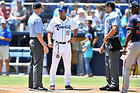 First base umpire Mike Snover, Asheville Tourists manager Warren Schaeffer (13) and home plate umpire Emil Jimenez before a game between the Rome Braves and the Asheville Tourists at McCormick Field on July 30, 2017 in Asheville, North Carolina. The Braves defeated the Tourists 7-3. (Tony Farlow/Four Seam Images)