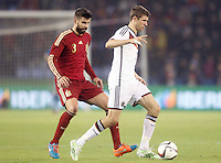 Spain's Gerand Pique (l) and Germany's Muller during international friendly match.November 18,2014. (ALTERPHOTOS/Acero) /NortePhoto<br />
