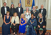 The five recipients of the 38th Annual Kennedy Center Honors pose for a group photo following a dinner hosted by United States Secretary of State John F. Kerry in their honor at the U.S. Department of State in Washington, D.C. on Saturday, December 5, 2015.  The 2015 honorees are: singer-songwriter Carole King, filmmaker George Lucas, actress and singer Rita Moreno, conductor Seiji Ozawa, and actress and Broadway star Cicely Tyson.  From left to right top: Ricky Kirshner; Glenn Weiss; United States Secretary of State John Kerry; Rita Moreno; George Lucas; and David M. Rubenstein, Chairman, John F. Kennedy Center for the Performing Arts.  From left to right bottom: Deborah F. Rutter, President, John F. Kennedy Center for the Performing Arts; Teresa Heinz-Kerry; Carole King; Cicely Tyson; and Seiji Ozawa.<br /> Credit: Ron Sachs / Pool via CNP