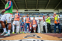 Swansea city players walk on to the pitch to warm up ahead of the  Premier League match between Swansea City and Everton played at the Liberty Stadium, Swansea  on September 19th 2015