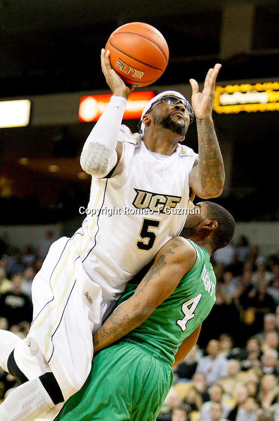January 5, 2011: Central Florida guard Marcus Jordan (5) drives for a layup during second half Conference USA NCAA basketball game action between the Marshall Thundering Herd and the Central Florida Knights. Central Florida defeated Marshall 65-58 at the UCF Arena Orlando, Fl..