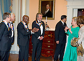John Paul Jones, Jimmy Page, Buddy Guy and Robert Plant, four of the seven recipients of the 2012 Kennedy Center Honors, applaud as United States Secretary of State Hillary Rodham Clinton arrives to pose for a photo following a dinner hosted by the Secretary at the U.S. Department of State in Washington, D.C. on Saturday, December 1, 2012.  The 2012 honorees are Buddy Guy, actor Dustin Hoffman, late-night host David Letterman, dancer Natalia Makarova, and the British rock band Led Zeppelin (Robert Plant, Jimmy Page, and John Paul Jones)..Credit: Ron Sachs / CNP