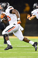Oklahoma State running back Rennie Childs (23) rushes with the ball during an NCAA football game, Saturday, November 22, 2014 in Waco, Tex. Baylor defeated Oklahoma State 49-28. (Mo Khursheed/TFV Media via AP Images)