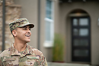 Happy young off duty US Army soldier Jaden at home, for sale as stock photography