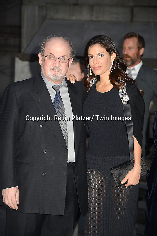 Salmon Rushdie and date attends the Vanity Fair Party for the 2013 Tribeca Film Festival on April 16, 2013 at State Suprme Courthouse in New York City.