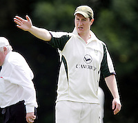 North London captain Jack Atchinson directs his team during the Middlesex County Cricket League Division Three game between Wembley and North London at Vale Farm, Wembley on Sat May 31, 2014