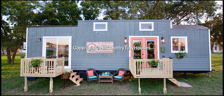 BNPS.co.uk (01202 558833)Pic: HillCountryTinyHouses/BNPS<br /> <br /> A couple have created a minuscule house on a trailer that means home is wherever people want it to be - without having to give up creature comforts.<br /> <br /> The 40ft custom-made trailer offers 384 sq ft of living space - smaller than the average UK one-bedroom home - but comfortably houses three people and has everything one might need including a dishwasher and a full-size jet spa bath.<br /> <br /> Shari and Todd Snyder had just finished renovating their dream home when they decided to sell their spacious 2,200 sq ft house and create their own tiny house to start a new business, Hill Country Tiny Houses.<br /> <br /> The project took five months with Todd, 49, who has been building and renovating houses for 15 years, custom-making the trailer from scratch and building their home with the couple's son Andrew, 12, this summer.