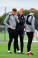 Joe Rodon speaks with Graham Potter Manager of Swansea City during the Swansea City Training Session at The Fairwood Training Ground, Wales, UK. Tuesday 11th September 2018