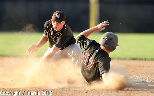 SIOUX FALLS, SD - AUGUST 9:  Cody Shepardson #17 from Brookings steals second base as Sam King #9 from Aberdeen looses the ball in a cloud of dust during the second inning Thursday night Harmodon Park. (Photo by Dave Eggen/Inertia)