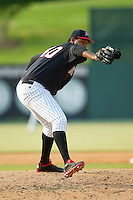 Kannapolis Intimidators relief pitcher Jefferson Olacio (40) in action against the Rome Braves at CMC-Northeast Stadium on June 16, 2013 in Kannapolis, North Carolina.  The Intimidators defeated the Braves 6-4.   (Brian Westerholt/Four Seam Images)